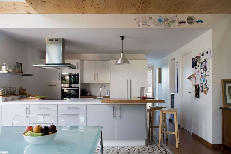 Beautiful contemporary kitchen in white with a smart peninsula and floating shelves