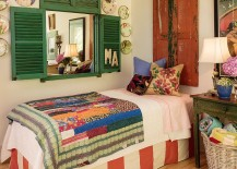 Beautiful shutters, flea market finds and pops of color for the shabby chic bedroom