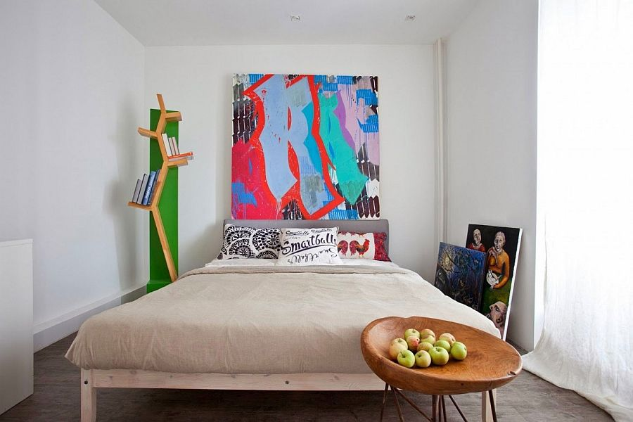 Bedroom in white with large modern art piece for the headboard wall
