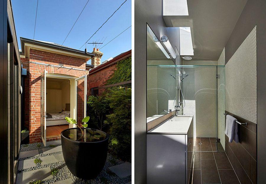 Bedroom with brick walls and contemporary bathroom