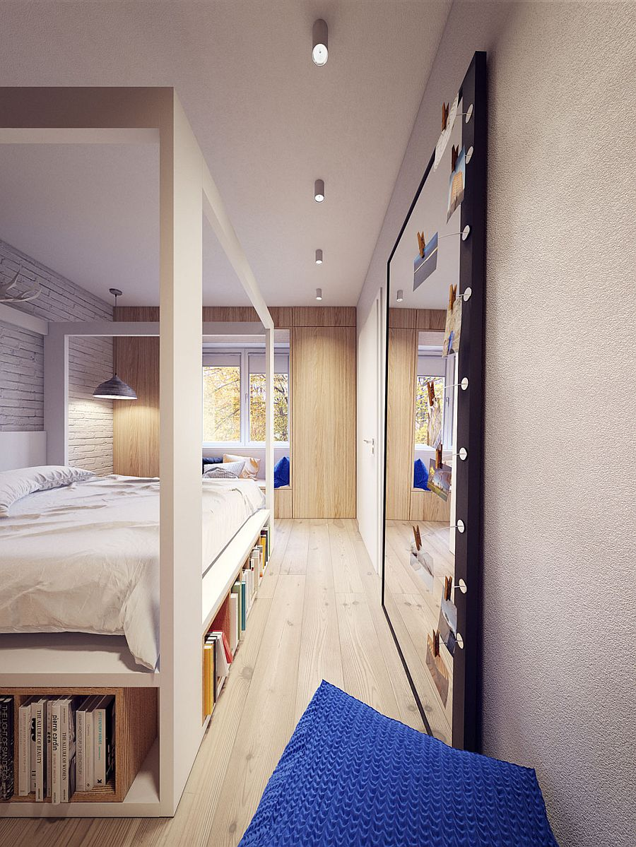 Bedroom with sleek Scandinavian style and a giant mirror