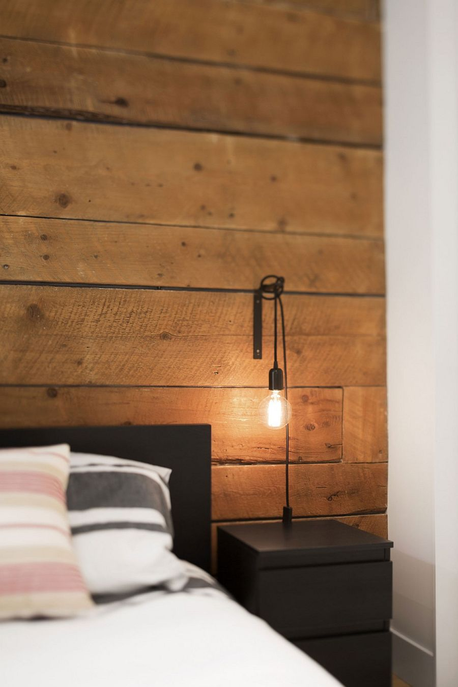 Bedside table and lighting add a touch of industrial charm