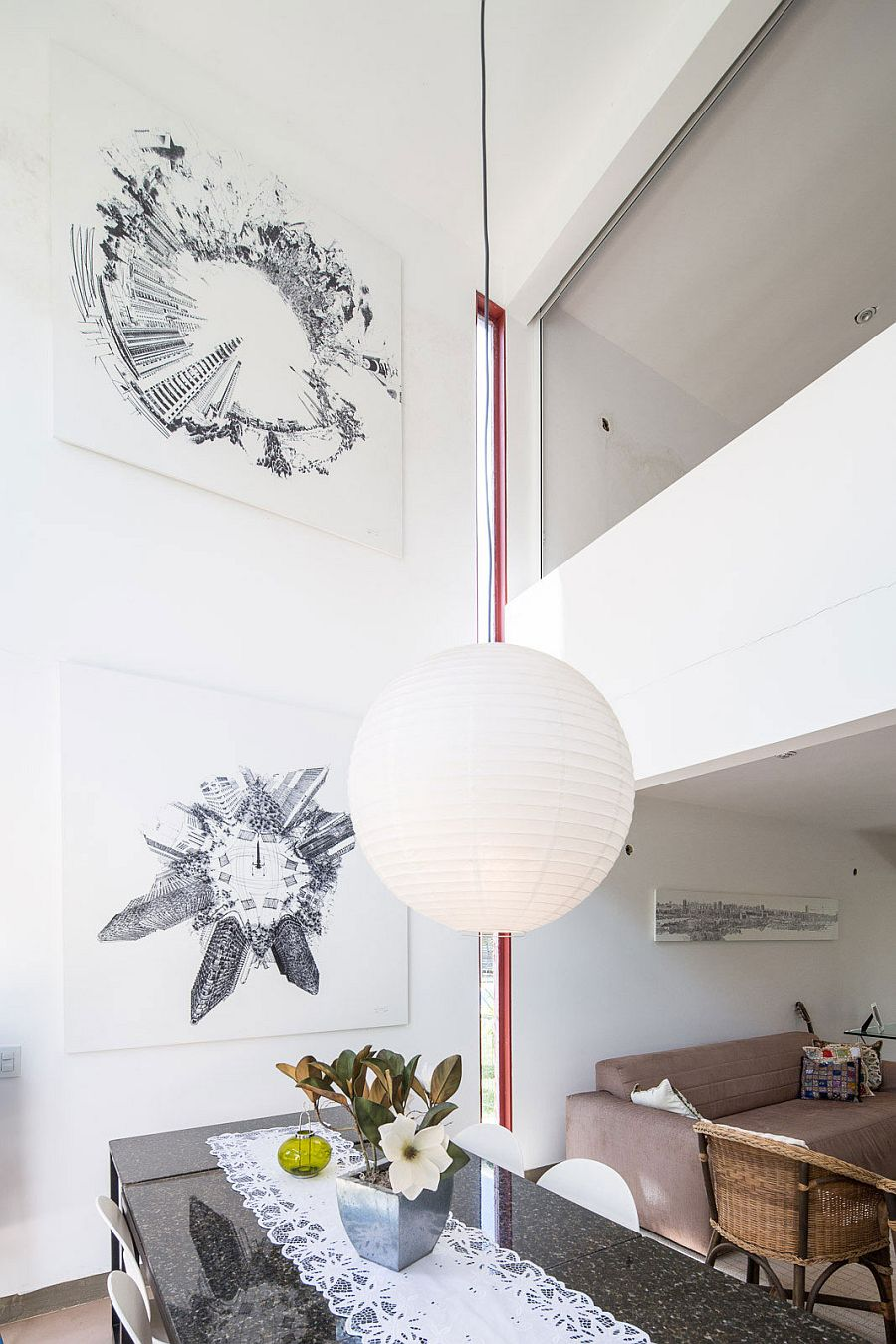 Black and white artwork creates a gallery style wall in the dining space