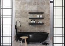 Black bathtub becomes the focal point of the contemporary bathroom