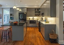 Black countertop and appliances offer lovely contrast in the all gray kitchen [From: Peter A. Sellar Photography / Vanbetlehem Architect]