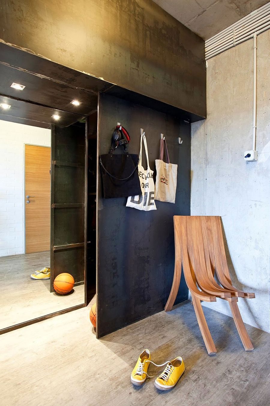 Black metal wall separates the living space from the entrance