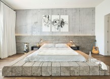 Bleached-salvaged-wood-used-to-create-custom-platform-bed-in-the-industrial-bedroom-217x155