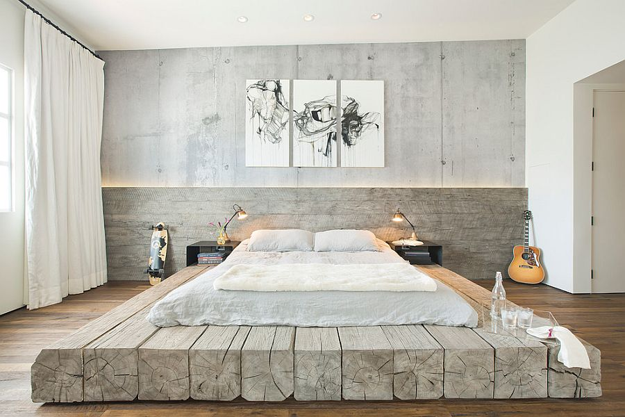 Bleached salvaged wood used to create custom platform bed in the industrial bedroom [Design: SUBU Design Architecture]