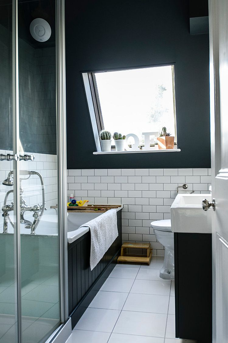 Blend of light and dark elements in the Scandinavian bathroom [Photography: Noah Darnell]