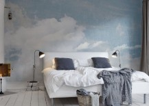 Blue and white cloud wallpaper behind a bed 217x155 15 Soothing Bedrooms That Take Inspiration from the Clouds