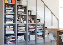 Bookshelf under the stairs creates a wonderful display