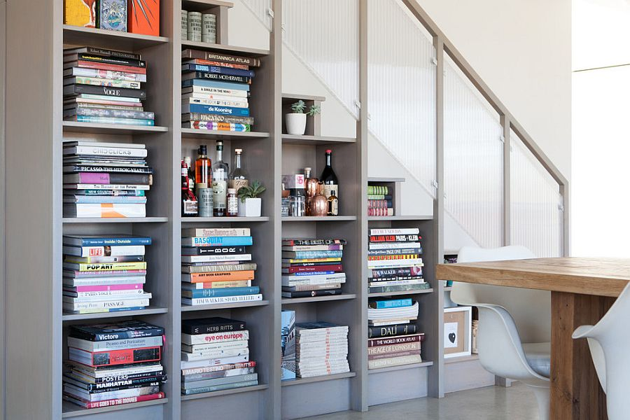Bookshelf under the stairs creates a wonderful display [Design: ACRE Goods + Services]