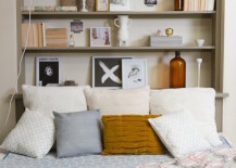 Bookshelf-with-bed-positioned-up-against-it-from-one-side-217x155