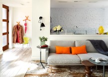 Brick wall in the backdrop becomes a part of the living room visual [Design: Donald Lococo Architects]