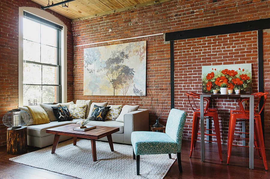 Bright and beautiful industrial loft living room [Design: Homepolish]