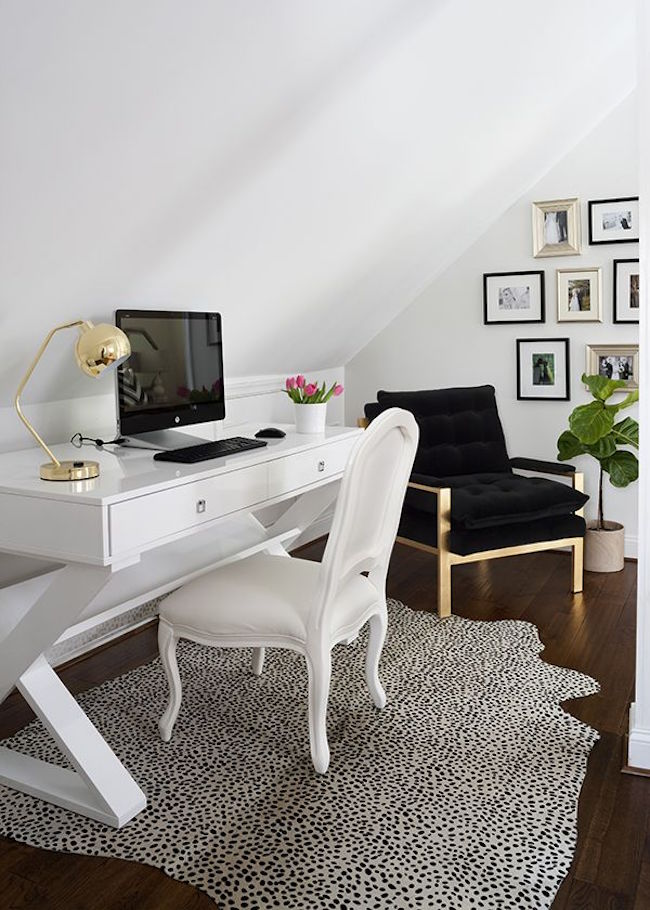 Bright and white attic office space with bold accents
