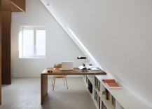 Bright attic with interesting desk for an office space