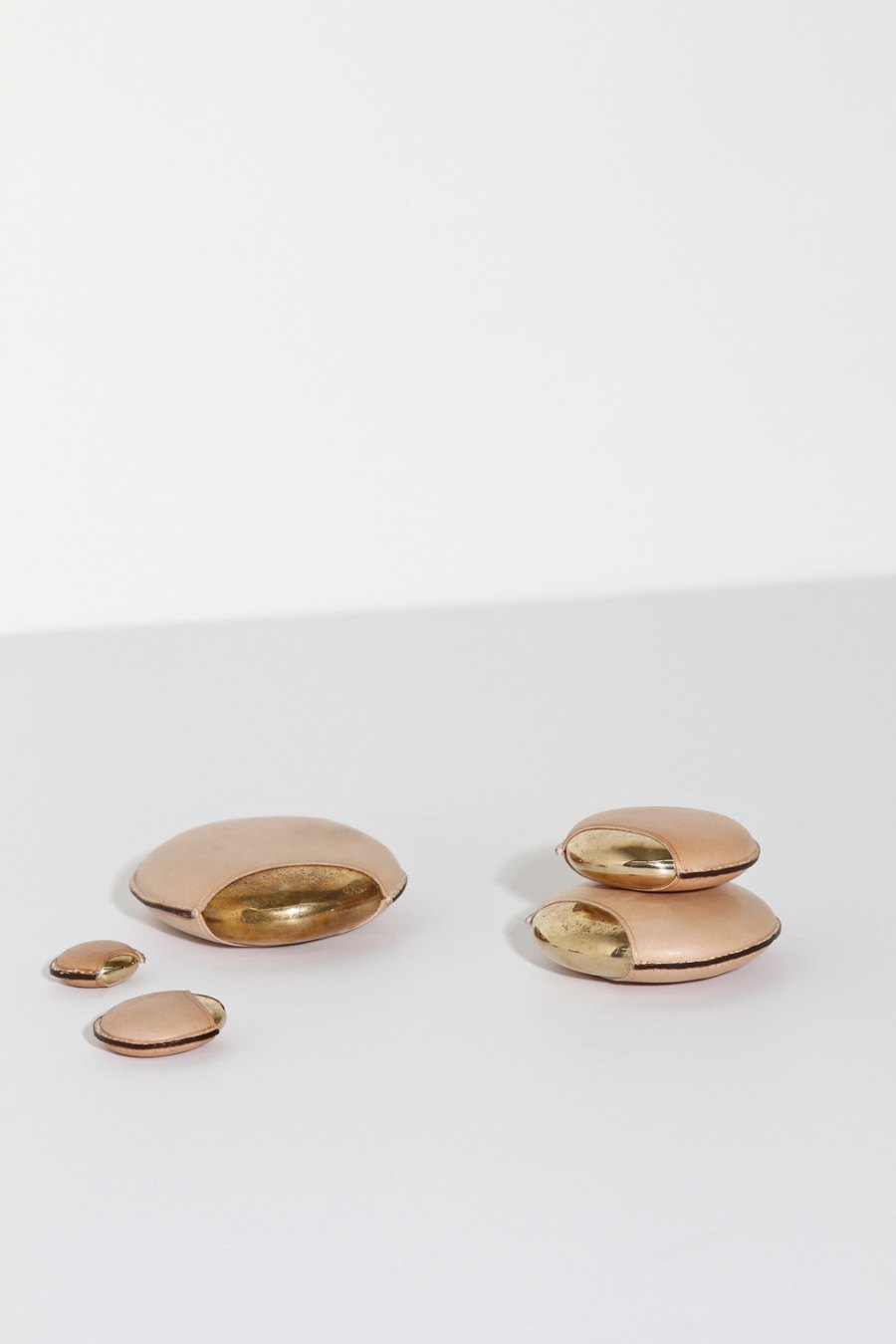Bronze and leather objects from Table of Contents Studio