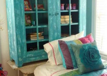 Cabinet turned bookshelf painted to match bedding
