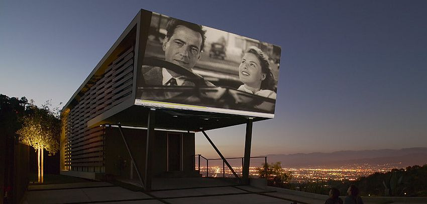 Carport overhang turned into a stunning projection screen [Design: Belzberg Architects]