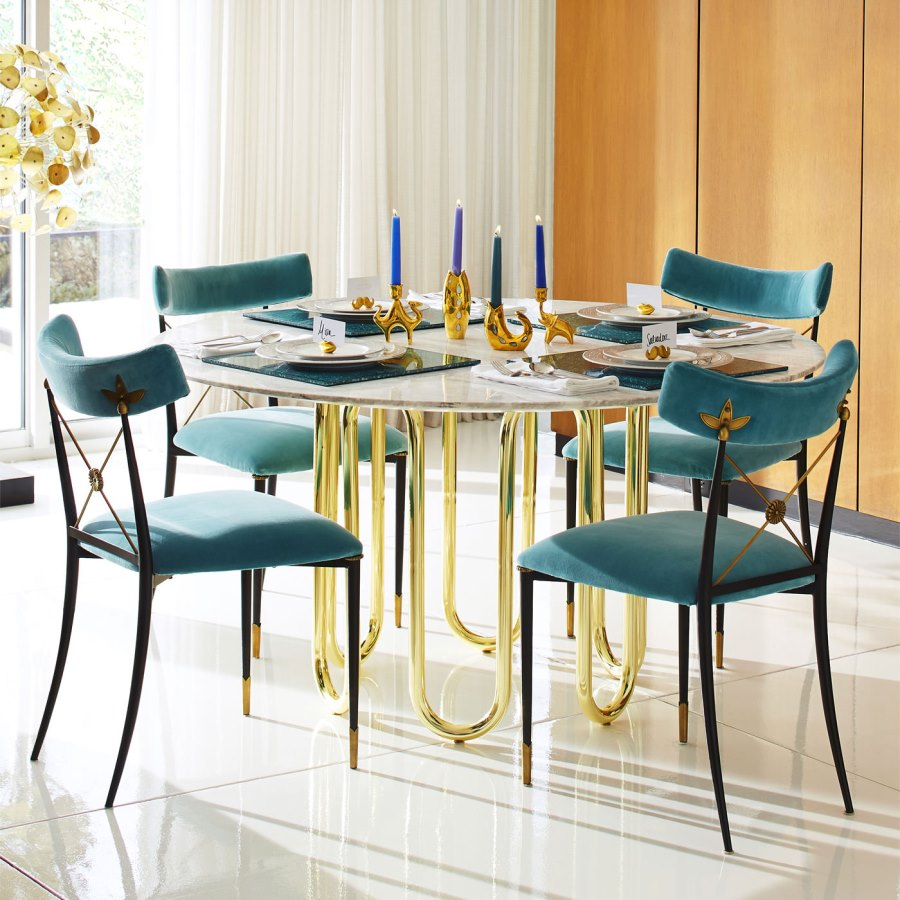 Carrara marble and brass dining table from Jonathan Adler
