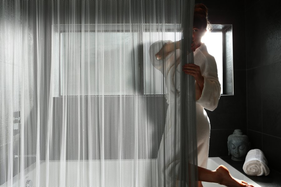 Cascade coil shower curtain