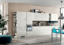 Central table in the kitchen complements the sleek style of the kitchen shelves in glossy white