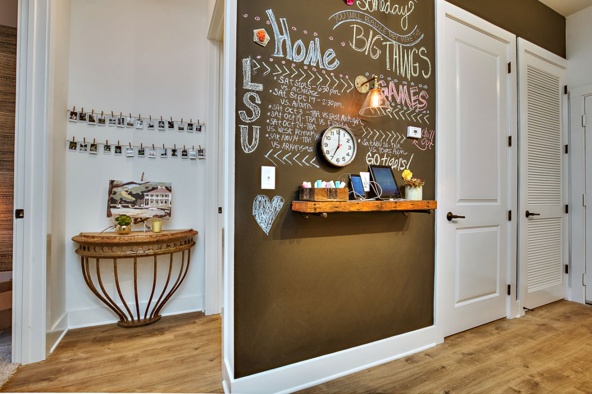 Chalkboard wall in the campus apartment is a pactical addition that also adds aesthetics