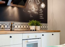 Chalkboard wall in the kitchen adds spunk to the interior