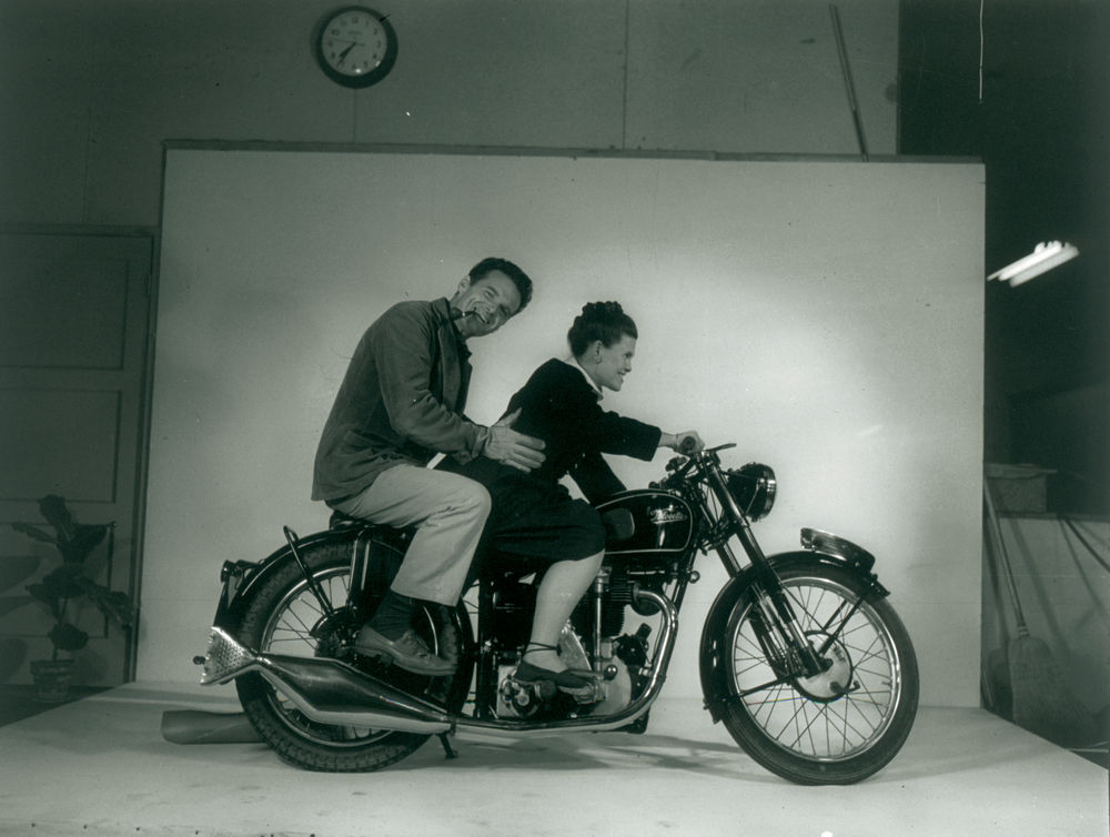 Charles & Ray Eames riding a motorcycle in 1948