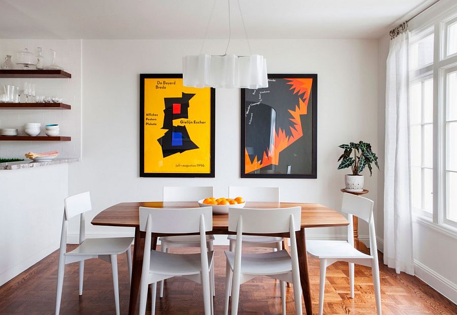 Cheerful dining room in white with Logico pendant and framed posters
