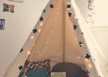 Classic and simple teepee stocked with pillows and books