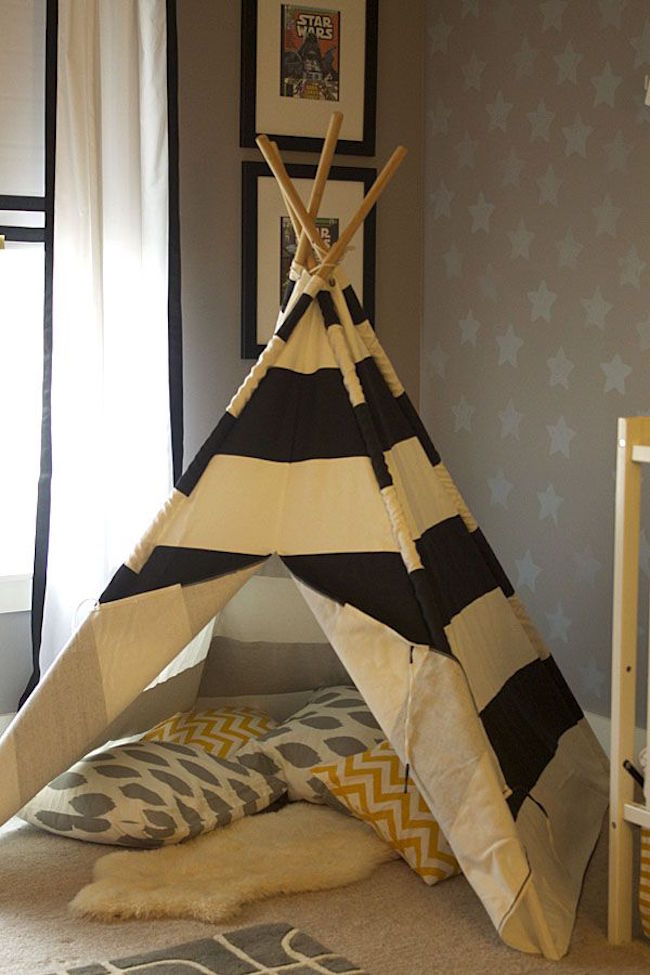 Teepee made with sticks and striped fabric 15 Whimsical Teepee Reading Nooks for Kids 15 Whimsical Teepee Reading Nooks for Kids Classic teepee made with sticks and striped fabric