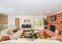 Classy brick wall adds a touch of traditional charm to the living room [Design: Pro Staged Homes]