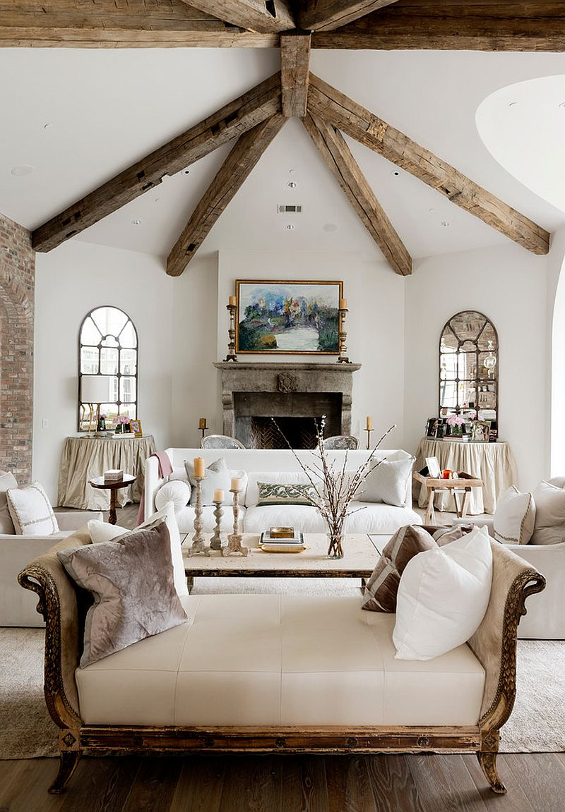 Classy chaise lounge and wooden beams inside the lovely living room [Design: Thompson Custom Homes]