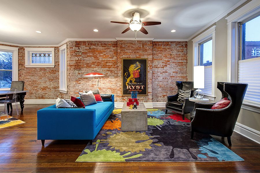 Colorful couch in blue rug and plush chairs make a vivacious living room design