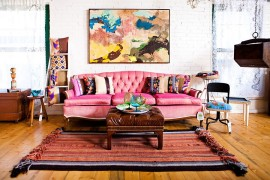 Colorful couch in pink and lovely wall art for the shabby chic living space