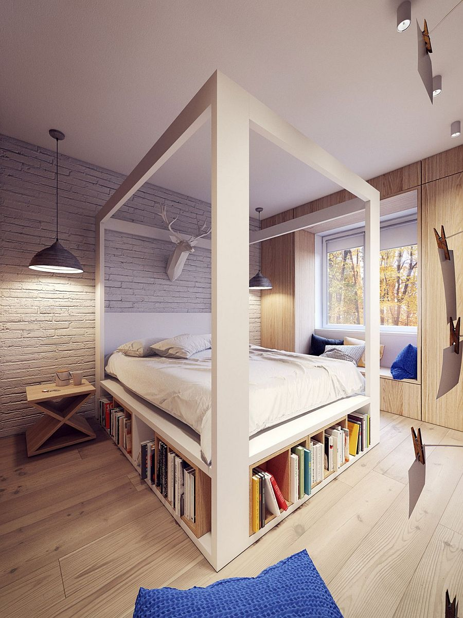 Contemporary bedroom with four poster bed and a chic window seat