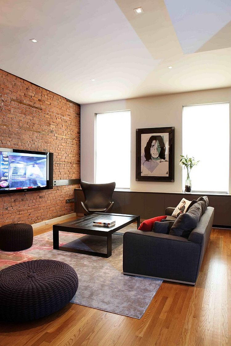 Contemporary living room with red brick wall and the classic Egg Chair [Design: valerie pasquiou interiors + design]