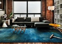 Contemporary living space with rug in copper blue and plush sofa in dark gray