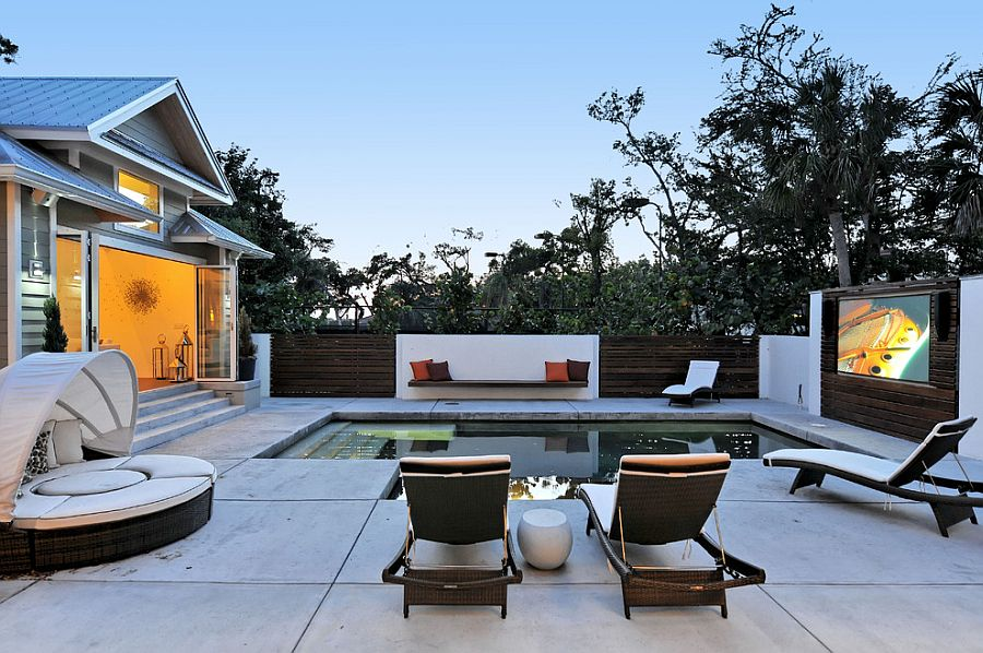 Contemporary pool area turned into outdoor movie space [Design: SmartHouse Integration LLC]