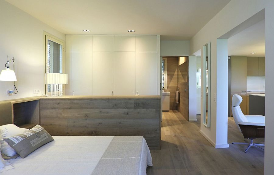 Continuous furniture design in the bedroom creates a room within a room