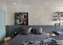 Cool gray coupled with concrete walls in the contemporary bedroom
