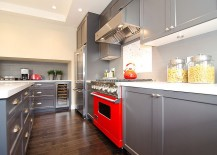Cool gray kitchen cabinets coupled with a hint of red