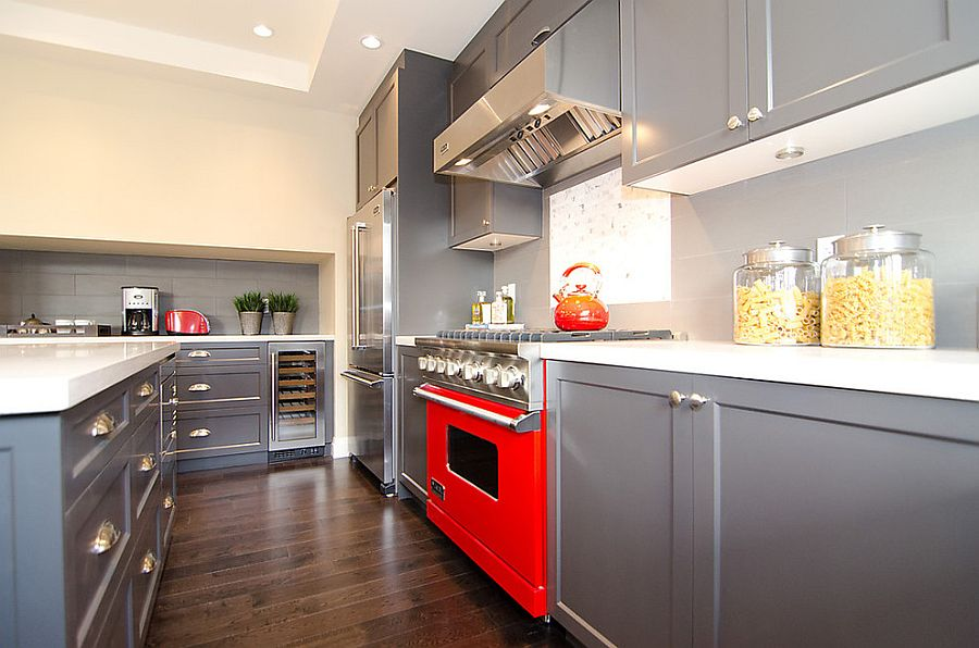 Cool gray kitchen cabinets coupled with a hint of red [Design: Odenza Homes]