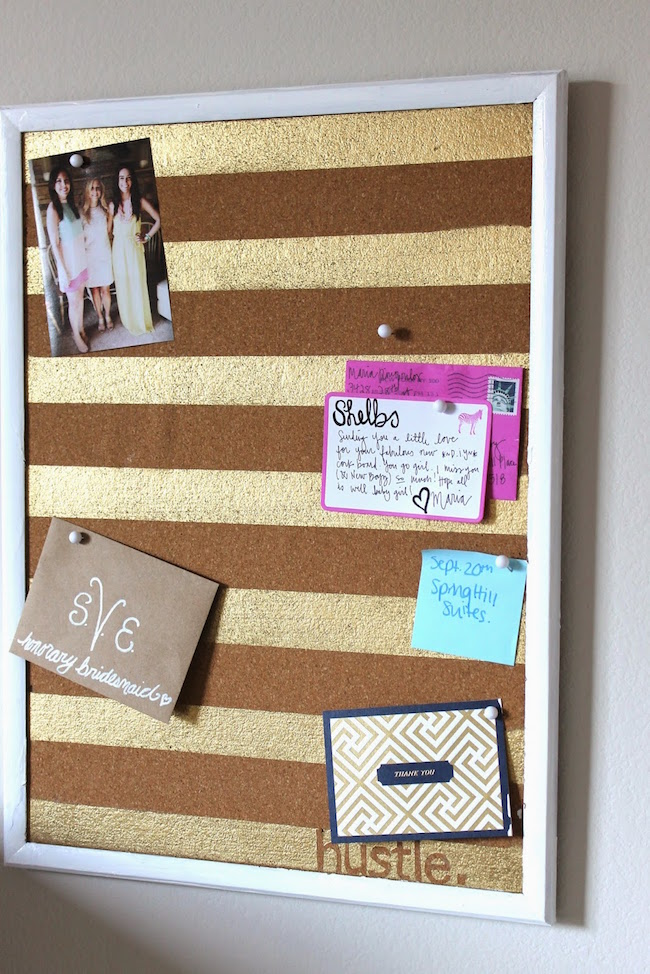Cork board with gold painted stripes