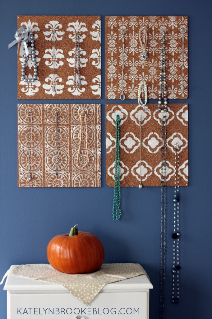 Cork board with stencil patterns used as a jewelry organizer
