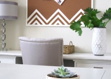 Cork board with white zigzag designs at the bottom