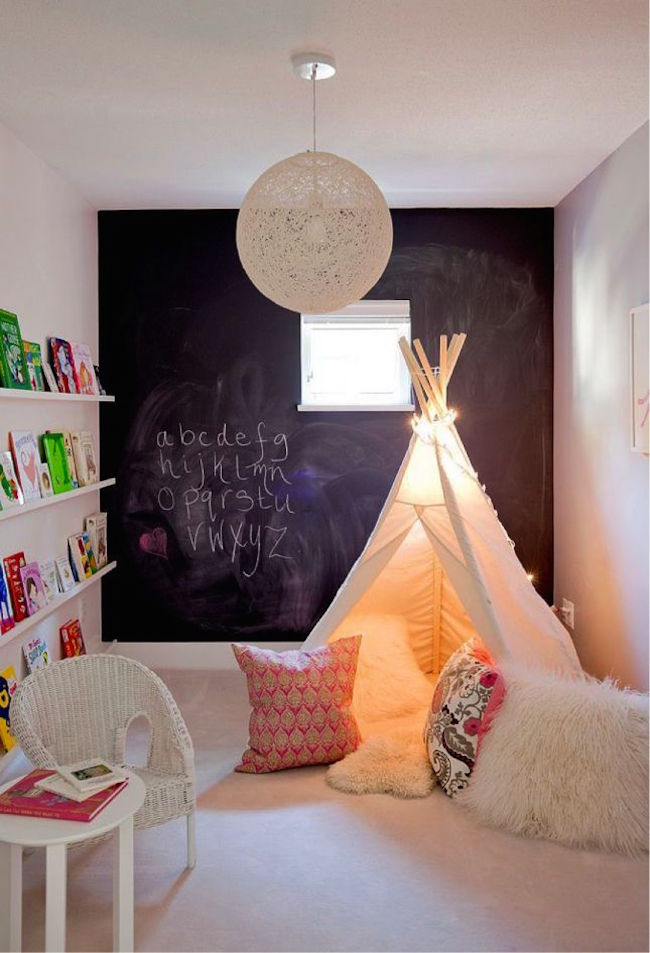 Cozy white teepee with lots of comfy pillows