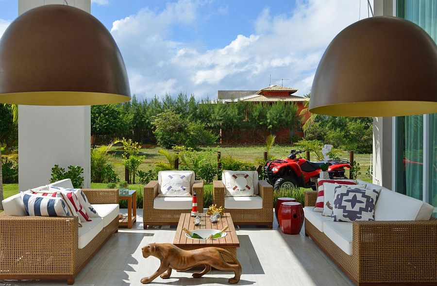 Create a fabulous outdoor lounge next to the pool with breezy outdoor furniture